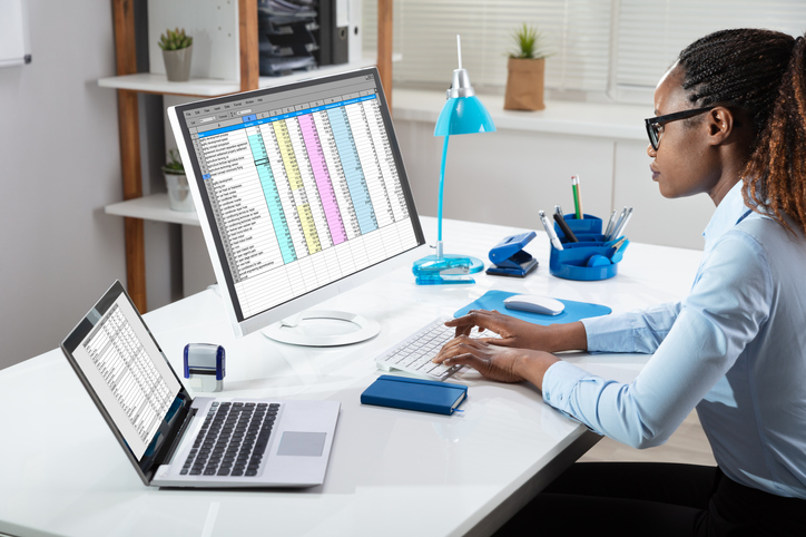 Businesswoman Analyzing Data On Computer